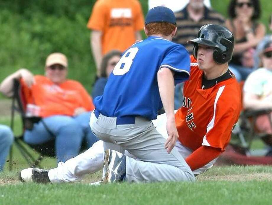 Special to the Press  06.03.12. Haddam-KillingworthÕs Wes Nuhn takes a practice pitch in SundayÕs state class M baseball quarterfinal. Rain stopped the game midway through the fourth inning with H-K leading, 1-0. To buy a glossy print of this photo and more, visit www.middletownpress.com