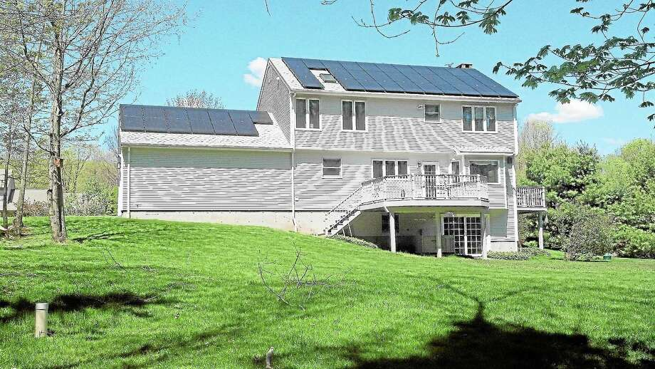 Submitted photo A view of Scott Mitchell's Durham house, which has 44 solar panels on its roof turning the sun's energy into usable power. Photo: Journal Register Co.