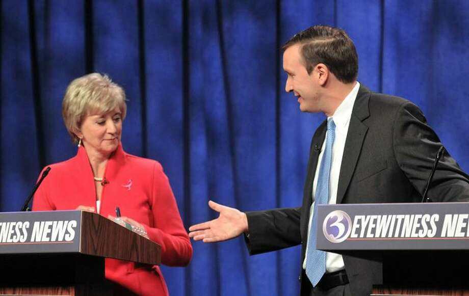 Linda McMahon seems to think twice about accepting a handshake from Chris Murphy after their fiery debate. This was the first meeting of the two in the battle for the U.S. Senate seat being vacated by Joe Joe Lieberman, who is retiring. Photo Peter Casolino/New Haven Register