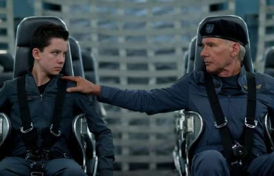"Asa Butterfield, left, and Harrison Ford in a scene from ""Ender's Game."""