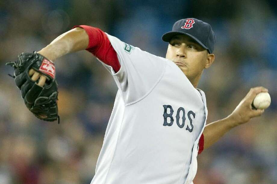 ASSOCIATED PRESS Boston Red Sox starting pitcher Felix Doubront works against the Toronto Blue Jays during the first inning of Saturday's game in Toronto on Saturday. The Red Sox won the game 7-4.