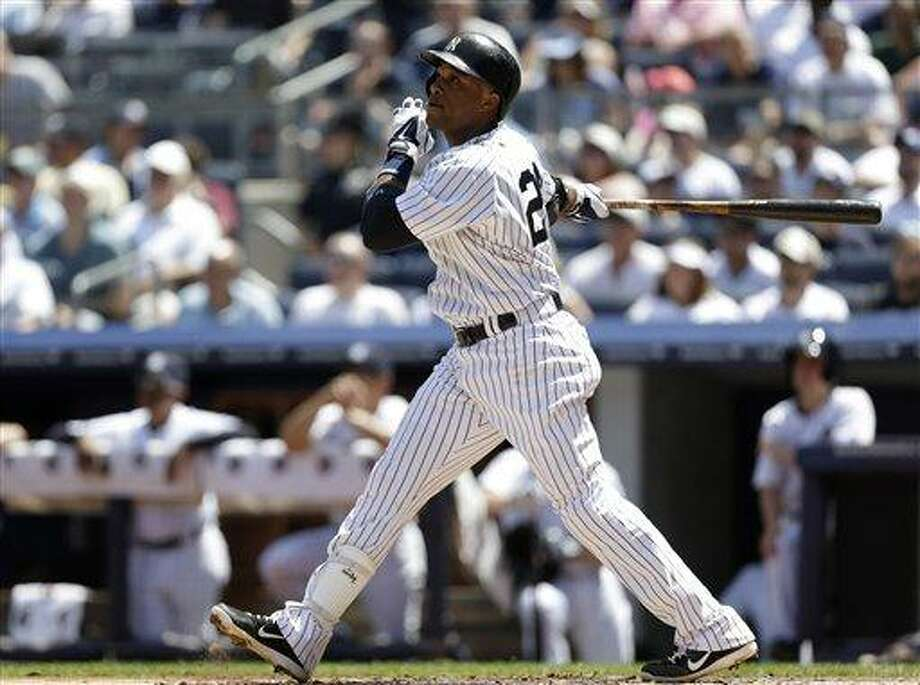 New York Yankees Robinson Cano hits a first-inning sacrifice fly in a baseball game against the Tampa Bay Rays, Sunday, June 23, 2013, in New York. (AP Photo/Kathy Willens) Photo: AP / AP
