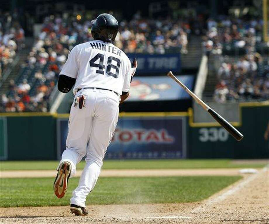Detroit Tigers' Torii Hunter watches his sacrifice fly ball that scored Avisail Garcia to take a 5-4 lead over the Boston Red Sox in the eighth inning of a baseball game on Sunday, June 23, 2013, in Detroit. (AP Photo/Duane Burleson) Photo: AP / FR38952 AP