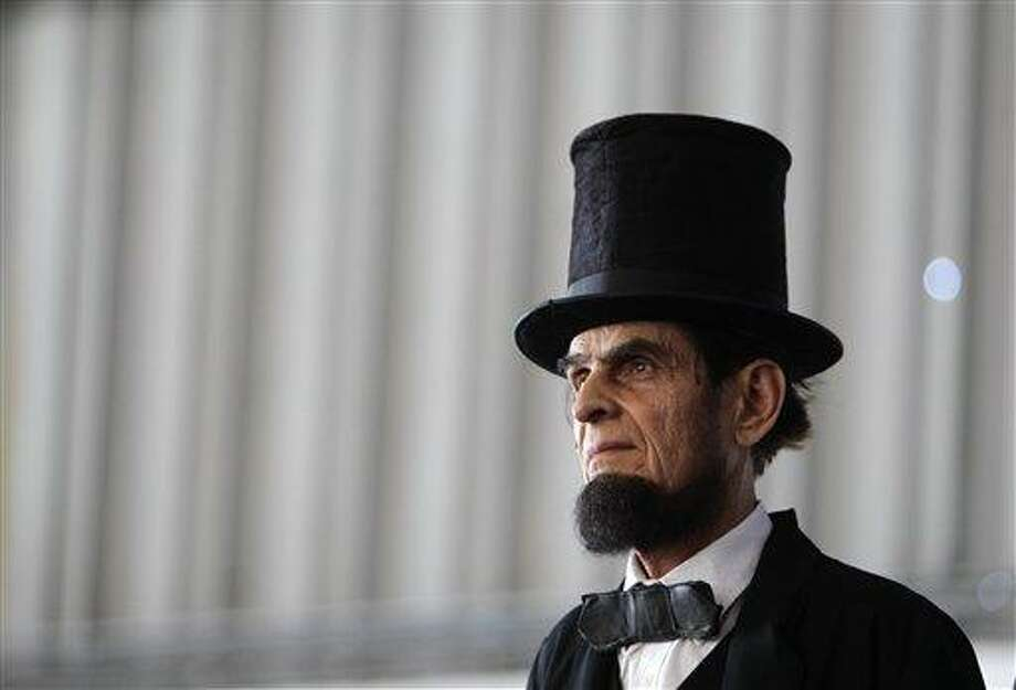 Actor Gerald Bestrom, dressed as Abraham Lincoln, attends a political function in January. Ford's Theatre has announced a plan to devote a museum and education center to the nation's 16th president. Associated Press Photo: AP / AP