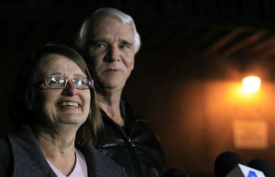 Jim Reynolds, 66, right, and wife, Karen Reynolds 57, recount their experience during a news conference Wednesday, Feb. 13, 2013, in Big Bear Lake, Calif., of being held captive by fugitive Christopher Dorner inside a condo unit they own at Mountain Vista Resort. AP Photo/Los Angeles Times, Brian van der Brug Photo: AP / Los Angeles Times