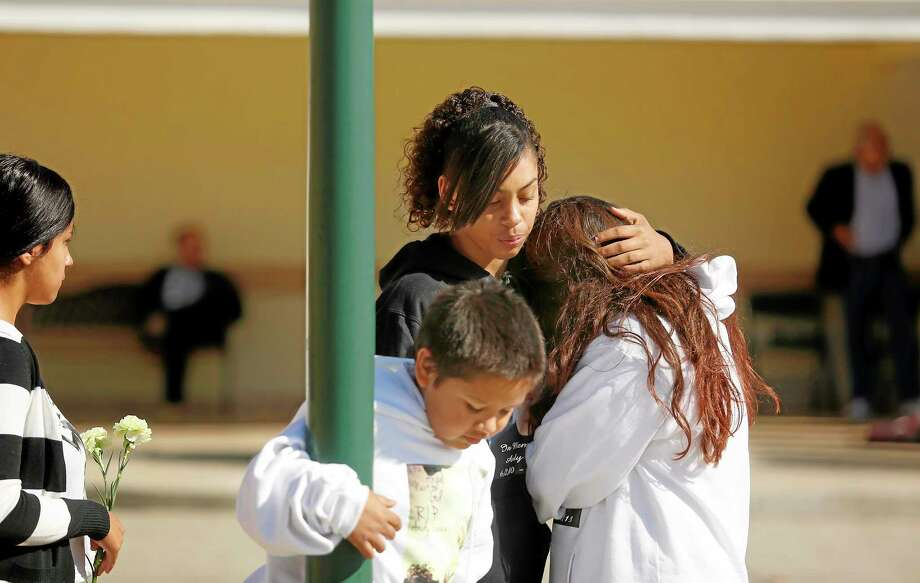 Mariah Burrham consoles her friend Aliyah Martinez during the memorial service and viewing of Andy Lopez at the Windsor-Healdsburg Mortuary on Sunday, Oct. 27, 2013. (AP Photo/The Press Democrat, Conner Jay) Photo: AP / The Press Democrat