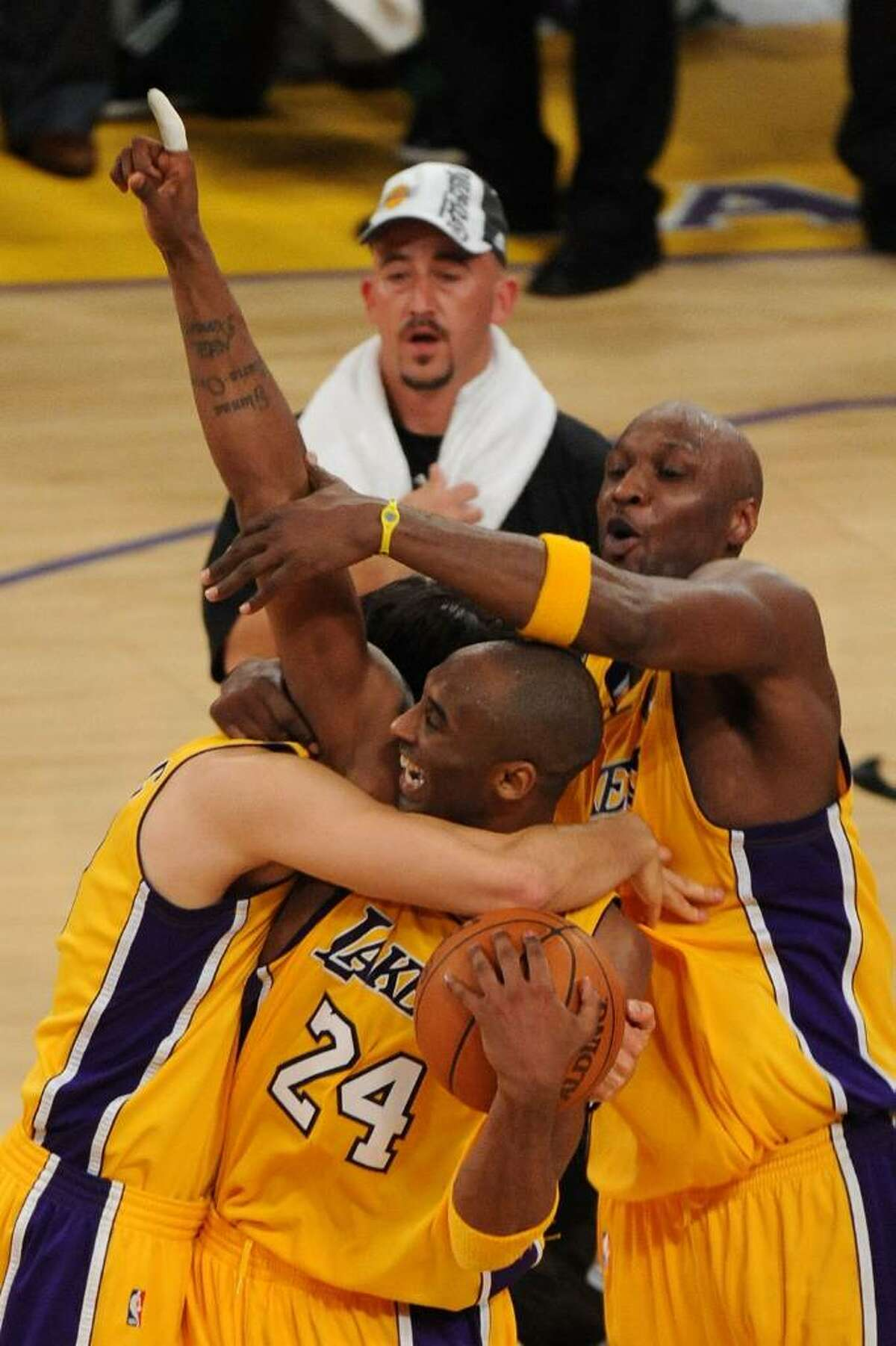 LOS ANGELES, CA - JUNE 17: Kobe Bryant #24, Lamar Odom #7 and Sasha Vujacic #18 of the Los Angeles Lakers celebrate after winning the 2010 NBA Championship 83-79 against the Boston Celtics in Game Seven of the 2010 NBA Finals at Staples Center on June 17, 2010 in Los Angeles, California. NOTE TO USER: User expressly acknowledges and agrees that, by downloading and/or using this Photograph, user is consenting to the terms and conditions of the Getty Images License Agreement. (Photo by Lisa Blumenfeld/Getty Images) *** Local Caption *** Kobe Bryant;Sasha Vujacic;Lamar Odom