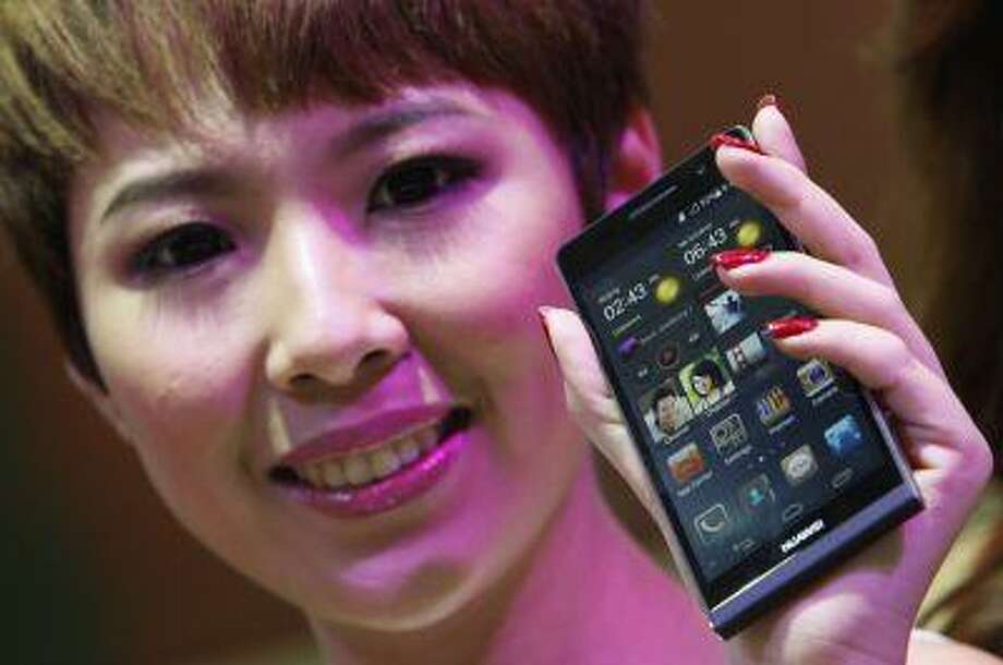 A model presents the Huawei Ascend P6 Android-based smartphone during their launch at the CommunicAsia communication and information technology exhibition in Singapore June 19, 2013. The smartphone is the world's slimmest, featuring a 4.7-inch high definition in-cell display and weighs approximately 120g, according to press release. (REUTERS/Edgar Su) Photo: REUTERS / X90125