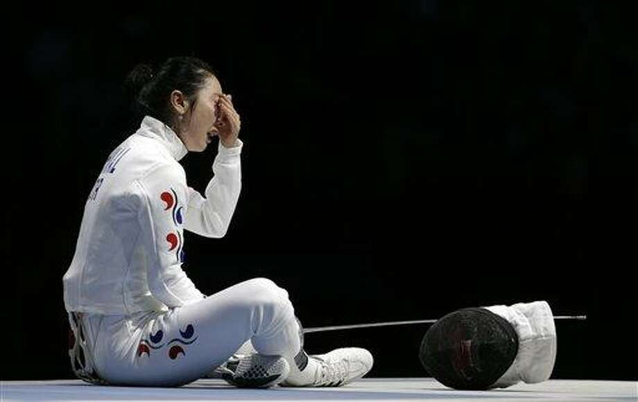 South Korea's Shin A-lam waits for an appeal to an officials decision after a women's individual epee fencing semifinals match against Germany's Britta Heidemann at the 2012 Summer Olympics, Monday, July 30, 2012, in London. (AP Photo/Andrew Medichini) Photo: AP / 2012 AP
