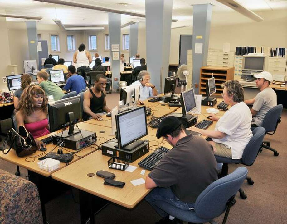 MIDDLETOWN PRESS FILE PHOTO - Residents visit the Russell Library in September 2011 due to power outages in the area.