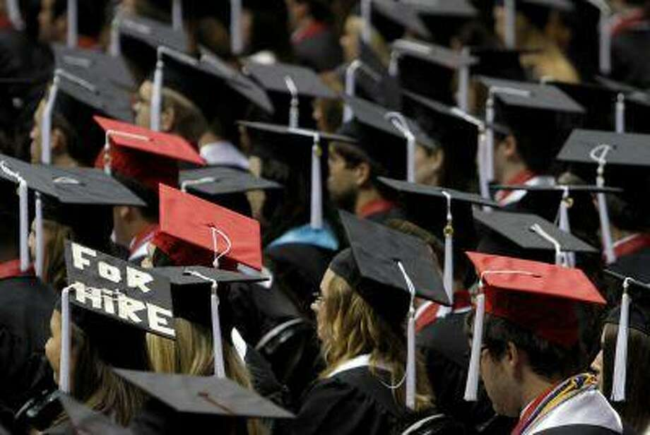 In this Saturday, Aug. 6, 2011 file picture, students attend graduation ceremonies at the University of Alabama in Tuscaloosa, Ala. (AP Photo/Butch Dill) Photo: ASSOCIATED PRESS / AP2011
