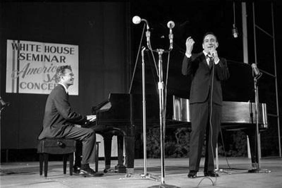 "This 1962 photo released by Columbia Legacy shows Dave Brubeck, left, and Tony Bennett performing in Washington. Bennett never forgot the first time he performed with Dave Brubeck more than half a century ago. But the tape of that memorable collaboration between two American jazz masters lay forgotten in a record label's vaults until its discovery by an archivist just weeks after Brubeck's death in December, and it's just been released as ""Bennett/Brubeck: The White House Sessions, Live 1962."" (AP Photo/Columbia Legacy) Photo: AP / Columbia Legacy net"
