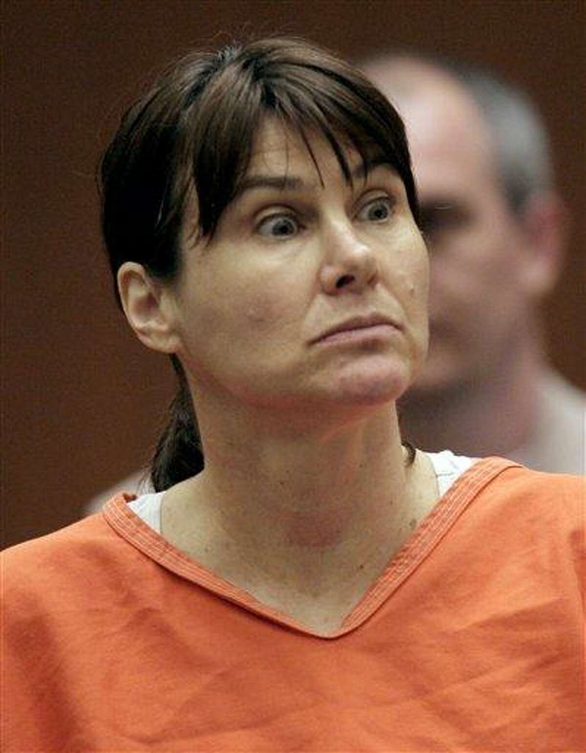 In this July 29, 2009 file photo, former Los Angeles police officer Stephanie Lazarus appears in court in Los Angeles. Lazarus is accused of killing an ex-boyfriend's wife 23 years ago when she was a young officer. Opening statements in Lazarus' trial begin Monday. Associated Press