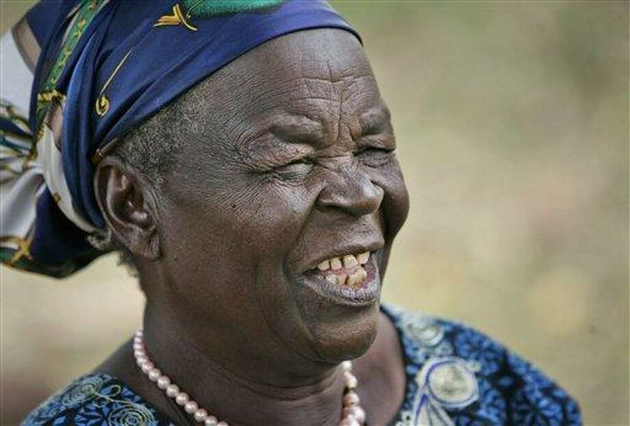 In this 2008 file photo, Sarah Obama, step-grandmother of U.S. President Barack Obama, sits in the backyard of her house in the village of Kogelo, near the shores of Lake Victoria, in Kenya. Obama's 91-year-old step-grandmother suffered bruises and shock after a car she was traveling in rolled over, a relative and a hospital official said Monday. Associated Press Photo: AP / AP