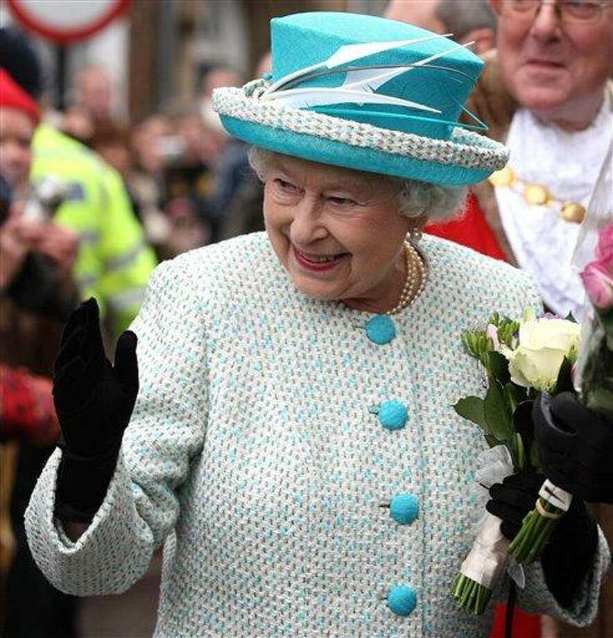Britain's Queen Elizabeth II, waves to well-wishers during a visit to Kings Lynn Town Hall in eastern England Monday. Associated Press Photo: AP / PA