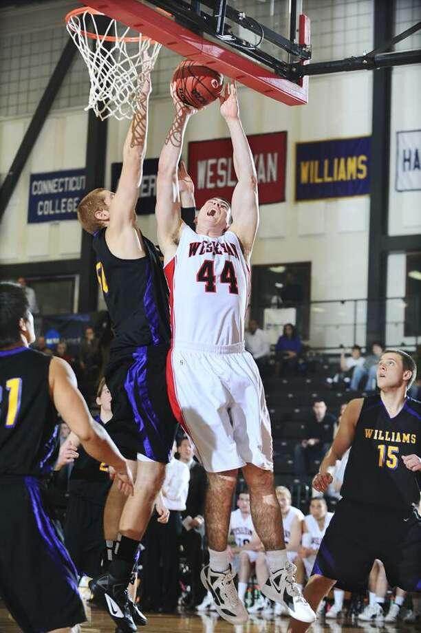 Wesleyan junior Mike Callaghan drives by Williams' Taylor Epley earlier this season.