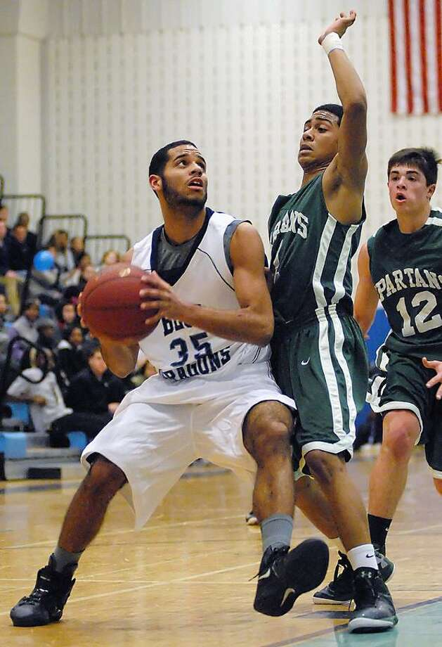 Catherine Avalone/The Middletown Press Andrew Campbell, pictured here driving against Maloney last week, has been a big part of Middletown's turnaround this year. Campbell, one of two seniors on the team, missed the first few games with a leg injury.