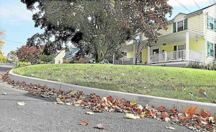 Concrete curbing on Clover Street in Middletown. Photo: Catherine Avalone - The Middletown Press   / TheMiddletownPress