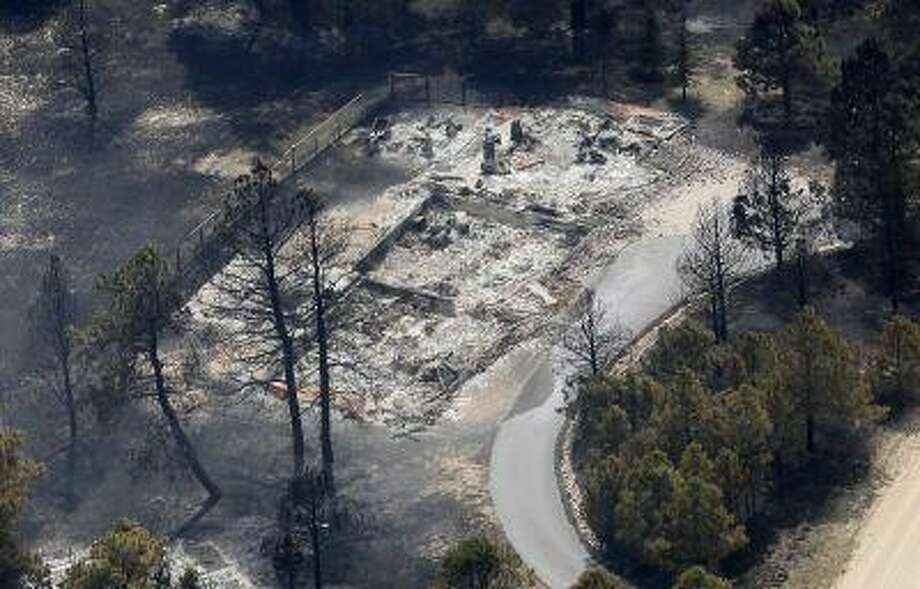 An aerial view of a destroyed house in the aftermath of the Black Forest Fire in Black Forest, Colorado June 13, 2013. (Rick Wilking/Reuters) Photo: REUTERS / X00301