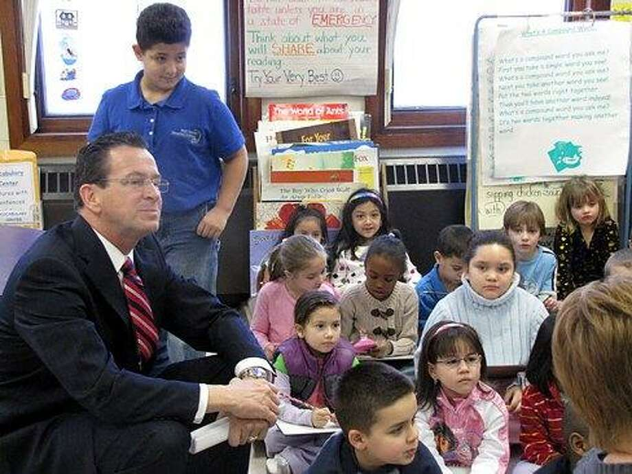 Gov. Dannel P. Malloy with kids at a Meriden School. Hugh McQuaid file photo