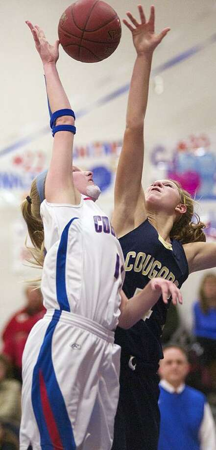 Catherine Avalone/The Middletown PressH-K junior center/forward Kiley Anderson battles Coginchaug junior forward Morgan Kuehnle for a rebound. The H-K Cougars came from behind to defeat the Coginchaug Blue Devils 43-39.