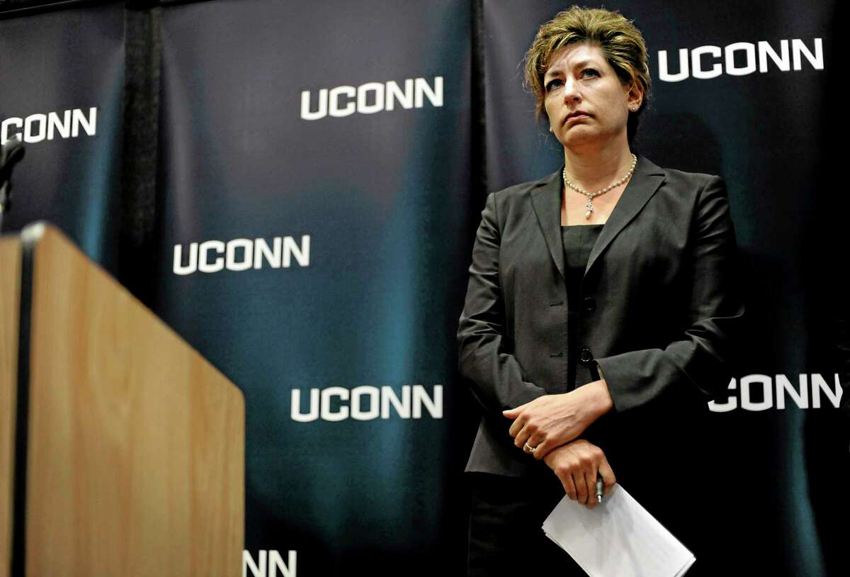 University of Connecticut President Susan Herbst listens to questions from media about the federal civil rights complaint filed Monday by seven women, Wednesday, Oct. 23, 2013, in Storrs, Conn. The women allege they were assaulted while attending UConn and that officials responded with deliberate indifference or worse. (AP Photo/Jessica Hill)