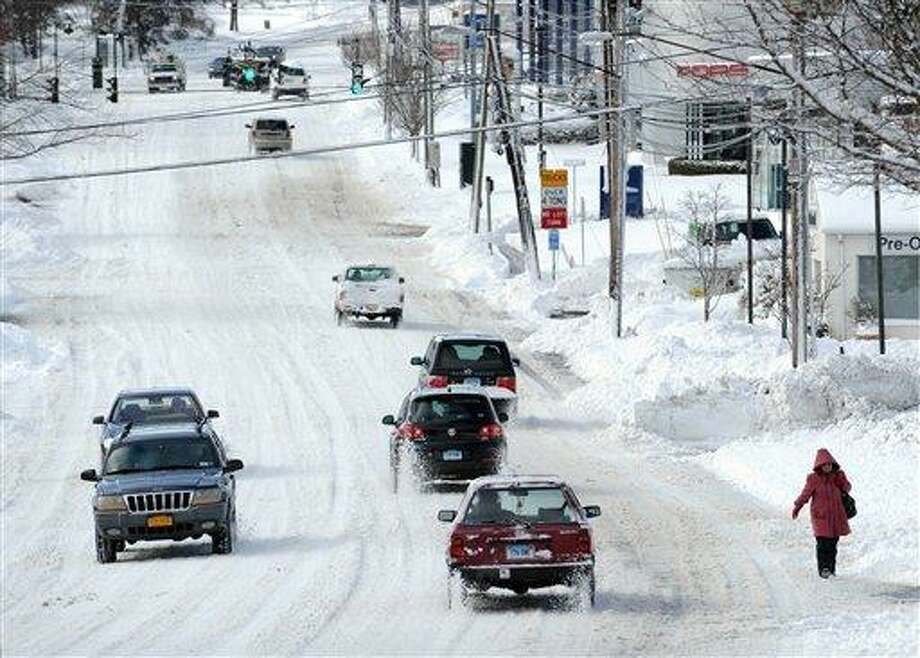 Cars drive along West Putnam Avenue during the aftermath of a blizzard in Greenwich, Conn., Saturday morning, Feb. 9, 2013. (AP Photo/Greenwich Time, Bob Luckey)  MANDATORY CREDIT; MAGS OUT Photo: ASSOCIATED PRESS / Greenwich Time2013