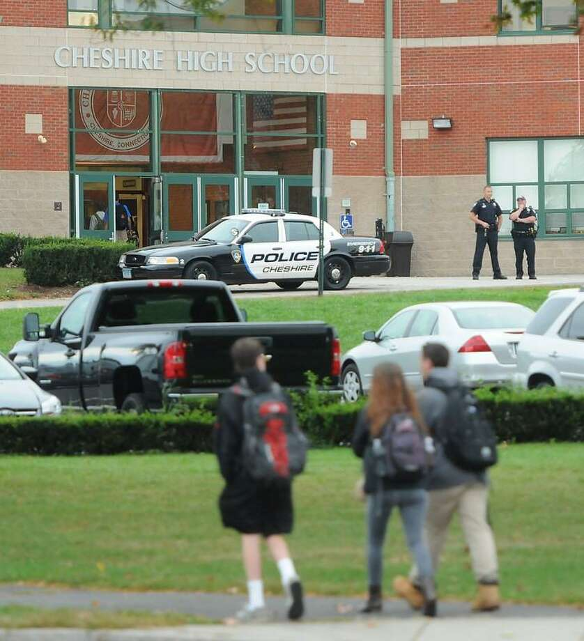 There is an increased police presence at Cheshire High School Tuesday morning after school officials discovered a threat written in a stall in one of the boys' bathrooms there. Peter Hvizdak/Register Photo: New Haven Register / ©Peter Hvizdak /  New Haven Register