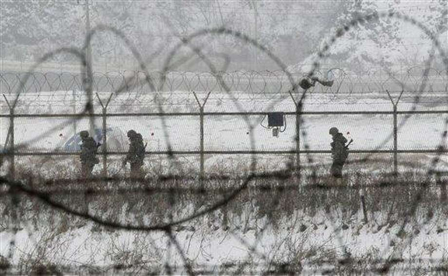 South Korean army soldiers patrol along barbed-wire fences at the Imjingak Pavilion, near the demilitarized zone of Panmunjom, in Paju, South Korea, Tuesday, Feb. 12, 2013. South Korea is confirming that North Korea has tested a nuclear device in defiance of U.N. orders to stop building atomic weapons. (AP Photo/Ahn Young-joon) Photo: AP / AP