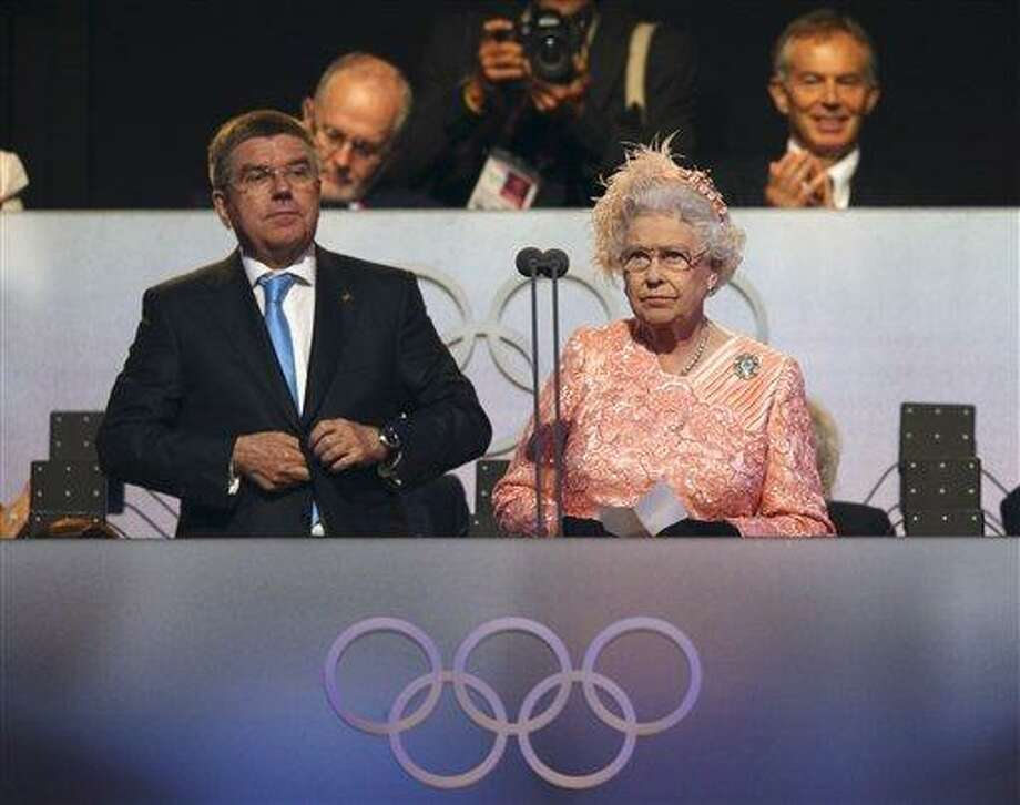 Britain's Queen Elizabeth II, right, declares the games open alongside International Olympic Committee Vice President Thomas Bach during the Opening Ceremony at  the 2012 Summer Olympics, Saturday, July 28, 2012, in London. (AP Photo/Cameron Spencer, Pool) Photo: AP / AP