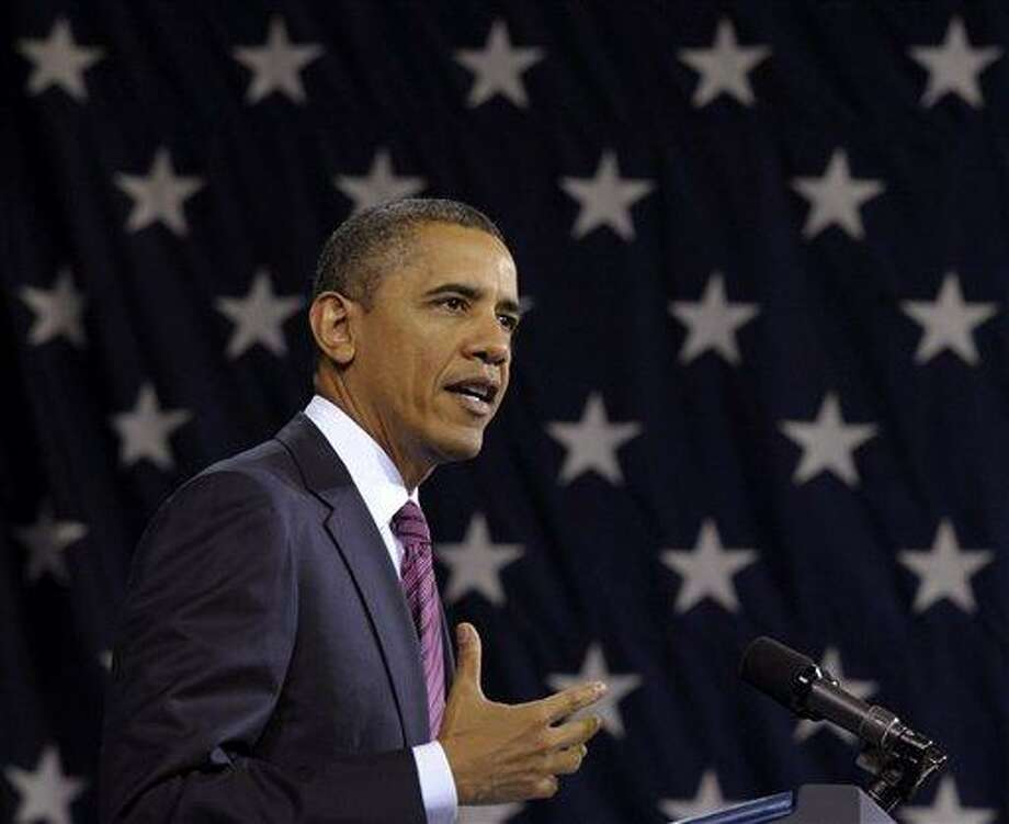 "FILE - In this Feb. 1, 2012, file photo President Barack Obama speaks in Falls Church, Va.  Obama, on Saturday, Feb. 4, 2012, called on the U.N. Security Council to stand up against Bashar Assad's ""relentless brutality"" and act as a credible advocate for human rights. In a blistering statement he said Assad had displayed ""disdain for human life and dignity"" following weekend attacks in the city of Homs that left more than 200 people dead. the unusual weekend Security Council session is considering a draft resolution backing an Arab League call for the Syrian leader to step down,  (AP Photo/Susan Walsh, File) Photo: AP / AP"