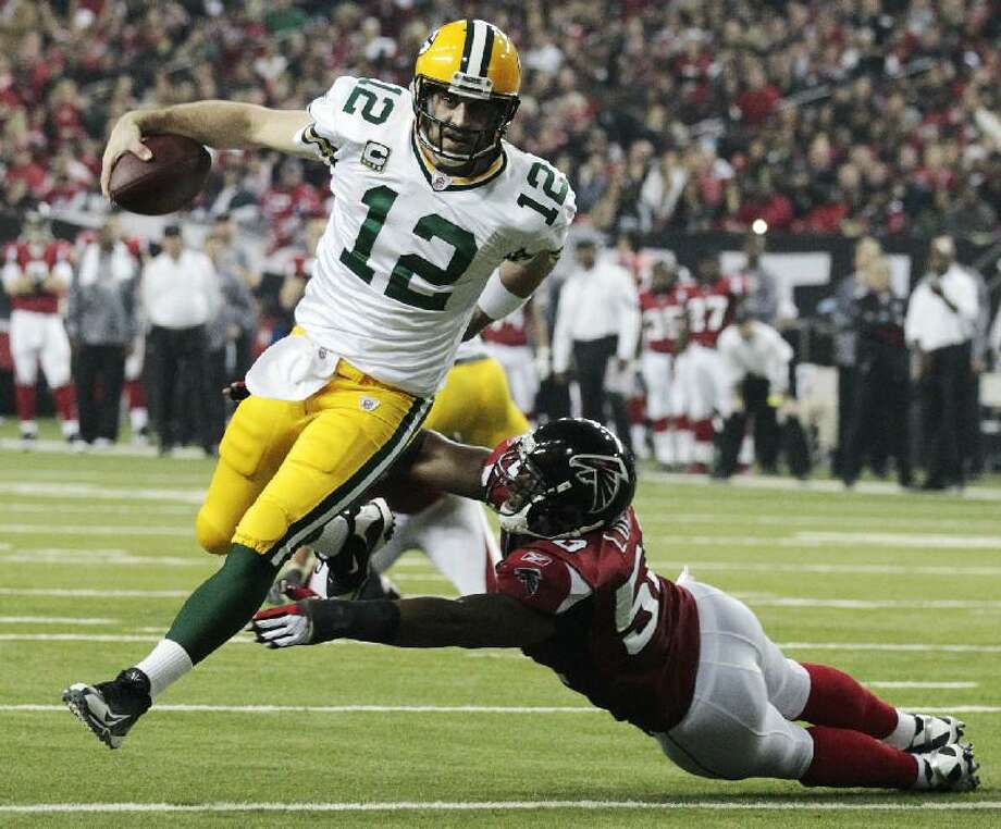 ASSOCIATED PRESS In this Jan. 15, 2011, file photo, Green Bay Packers quarterback Aaron Rodgers (12) scrambles past Atlanta Falcons linebacker Curtis Lofton (50) on a 7-yard touchdown run during the second half of an NFL divisional playoff game in Atlanta. Rodgers was selected as The Associated Press' NFL Most Valuable Player Award on Saturday.