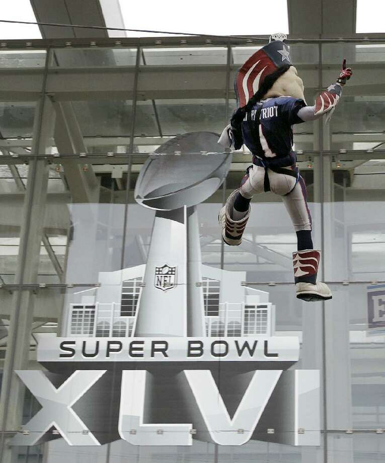 ASSOCIATED PRESS New England Patriots football team mascot Pat Patriot rides the zip line at Super Bowl Village in Indianapolis on Saturday. The New England Patriots will play the New York Giants in Super Bowl XLVI in Indianapolis Sunday.