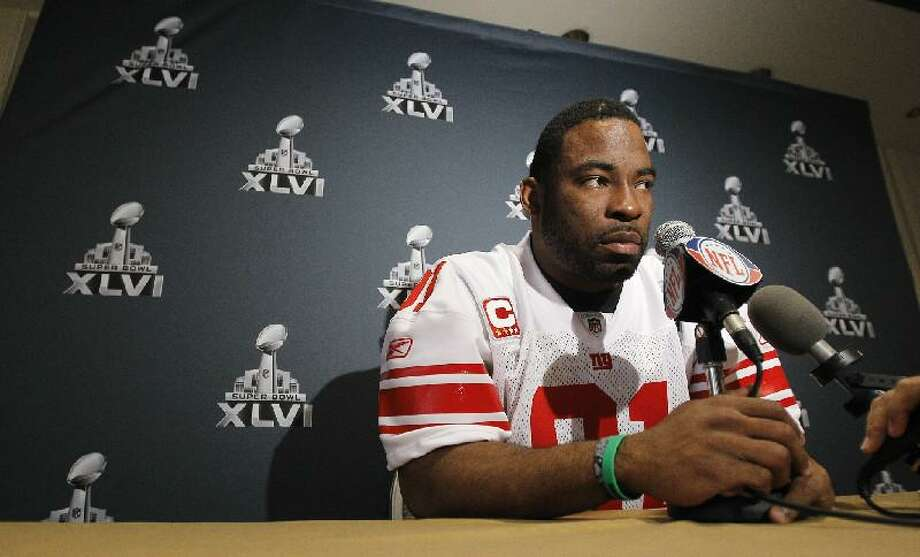 ASSOCIATED PRESS New York Giants defensive end Justin Tuck answers questions during a media availability Thursday in Indianapolis. The Giants will face the New England Patriots in the NFL football Super Bowl XLVI on Sunday.