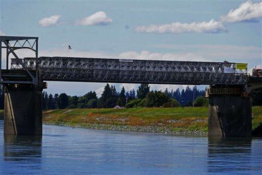 This Tuesday, june 18, 2013 photo shows the Interstate 5 bridge over the Skagit river, which is scheduled to reopen tomorrow, Wednesday June 19. (AP Photo/The Seattle Times, Mark Harrison) OUTS: SEATTLE OUT, USA TODAY OUT, MAGAZINES OUT, TELEVISION OUT, SALES OUT. MANDATORY CREDIT TO:  MARK HARRISON / THE SEATTLE TIMES Photo: AP / The Seattle Times