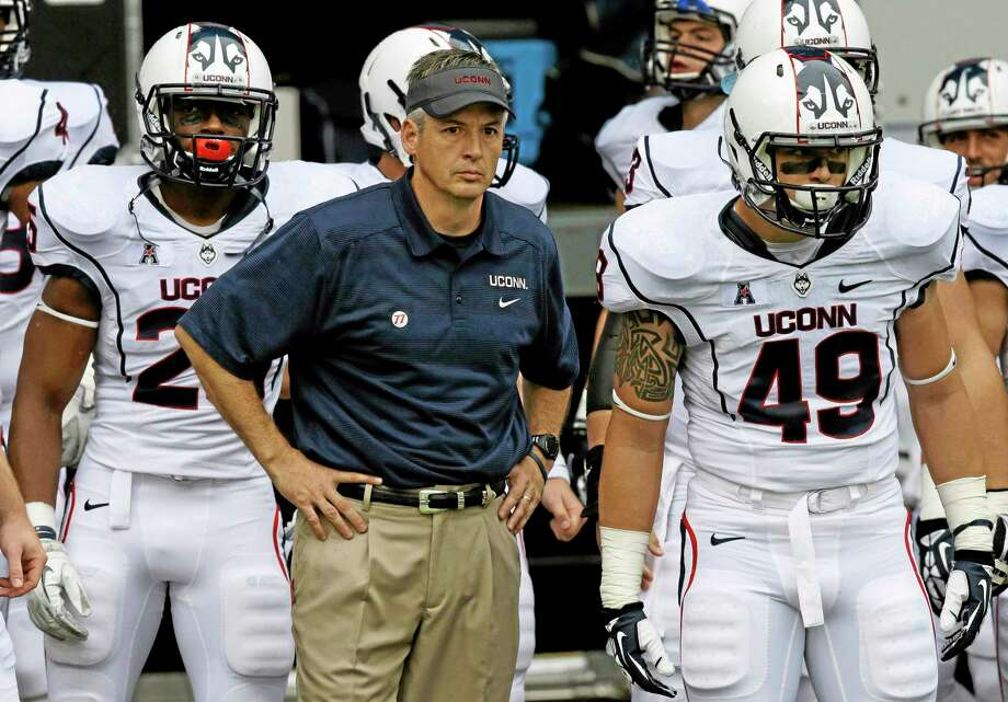UConn interim head coach T.J. Weist will try to lead the Huskies to their first win of the season on Saturday at No. 21 Central Florida. Photo: Al Behrman — The Associated Press  / AP