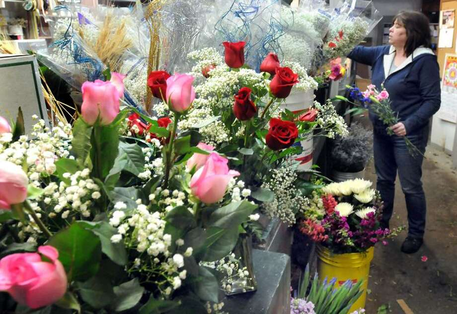 West Haven: Ginger Fowler, owner of Farricielllii's Flowers by Ginger is concerned about how the storm will affect her Valentine's Day orders and sales since so many customers were snowed in. Mara Lavitt/New Haven Register2/12/13