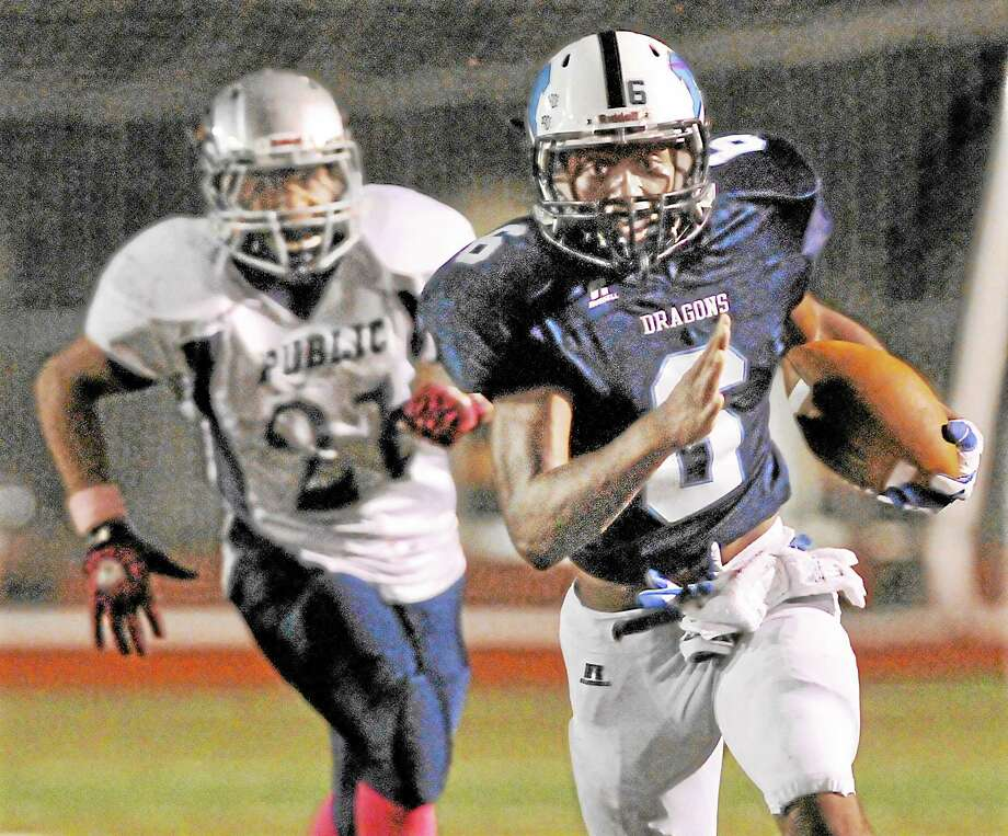 Middletown High School Blue Dragons (6-0) will take on Maloney-Meriden at Falcon Field in Meriden Friday night. Pictured is quarterback Dario R. Highsmith, Jr. in their win over Hartford Public. Catherine Avalone - The Middletown Press Photo: Journal Register Co. / TheMiddletownPress