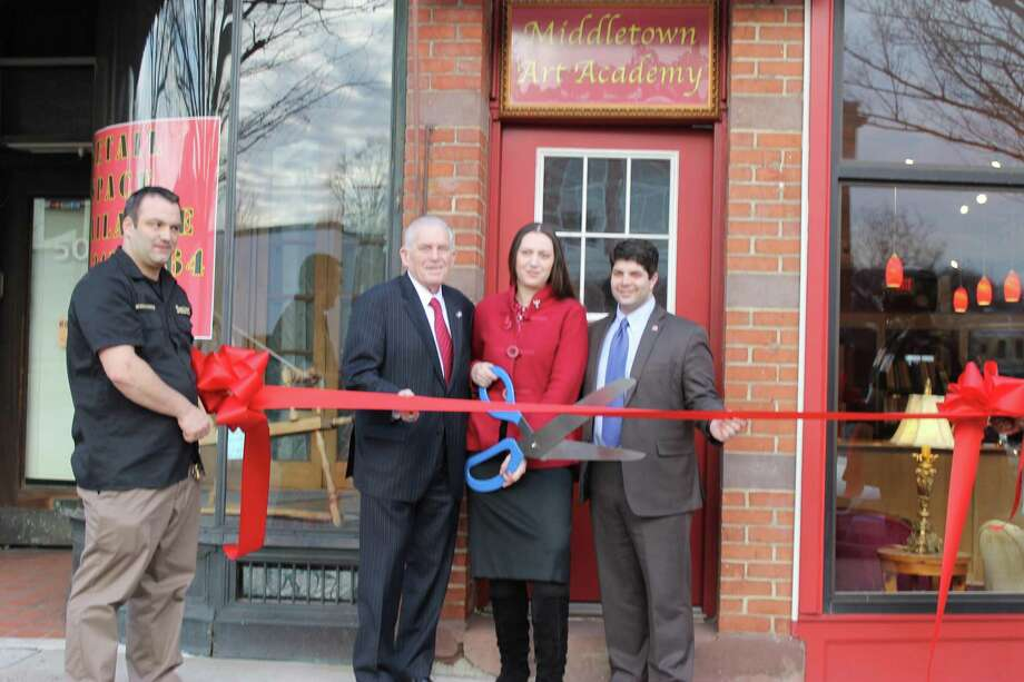 """Submitted photo ART ACADEMY: Middletown Art Academy held a Grand Opening on Thursday. From left, Dmitri D'Alessandro, Middlesex Chamber President Larry McHugh, Middletown Art Academy Founder Rusa D'Alessandro and Middletown Mayor Dan Drew. """"This business is a great new addition to downtown Middletown,"""" McHugh said."""