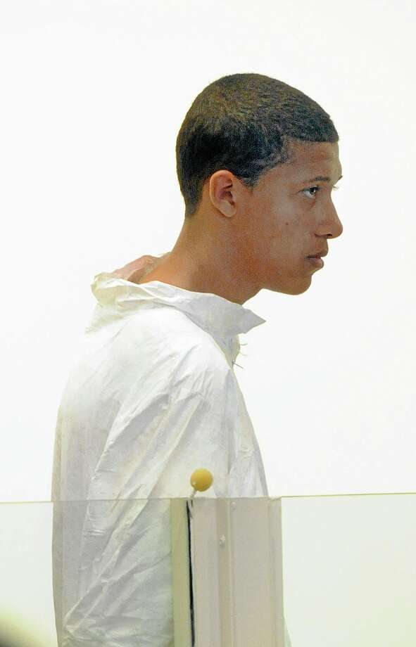 Philip Chism, 14, stands during his arraignment for the death of Danvers High School teacher Colleen Ritzer in Salem District Court in Salem, Mass., Wednesday, Oct. 23, 2013. Chism has been ordered held without bail. (AP Photo/Boston Herald, Patrick Whittemore) MANDATORY CREDIT Photo: AP / Patrick Whittemore/Boston Herald