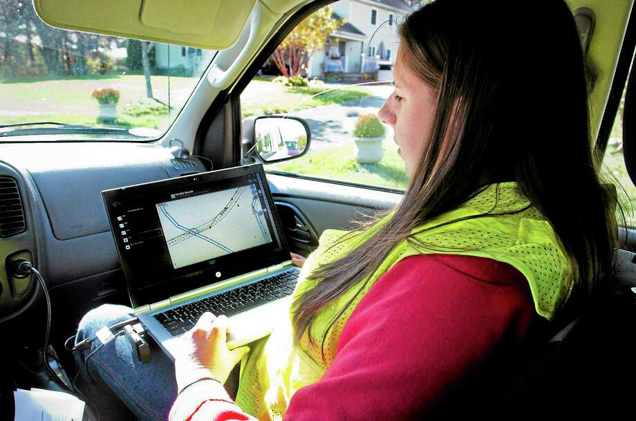 Melanie Stengel — New Haven Registe CL&P engineer Marissa Flynn demonstrates the new damage assesment software Thursday that, the company says, can help reduce the length of time that it may take to complete a large-scale restoration after significant storms. Photo: Journal Register Co.