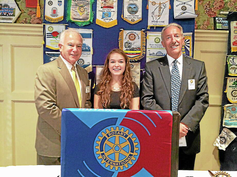 Submitted photoThe Middletown Rotary Club recently honored Kristen Burtt, center, a senior at Coginchaug Regional High School and resident of Durham, as Student of the Month for October. With her are Middletown Rotary President Garry Mullaney, left, and Middletown Rotarian Joseph Marino. Photo: Journal Register Co.