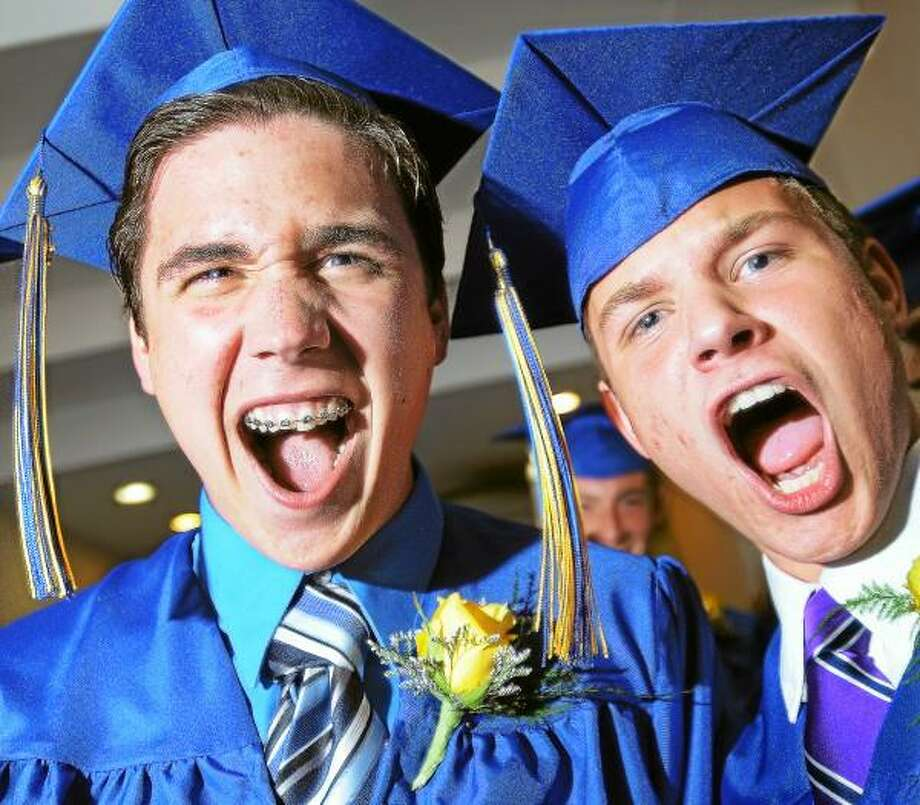 "Catherine Avalone/The Middletown Press Shadrach Vega and Anthony Paholski, both graduates of Vinal Technical High School's HVAC program chant ""Vinal, Vinal, Vinal"" in the hallway moments before marching into commencement Wednesday evening in the Grand Ballroom at the Crowne Plaza Hotel and Convention Center in Cromwell. / TheMiddletownPress"