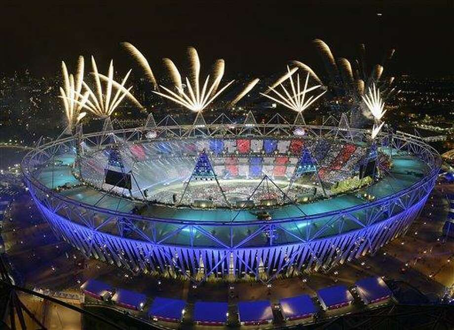 Fireworks illuminate the sky over Olympic Stadium during Opening Ceremonies at the 2012 Summer Olympics, Saturday, July 28, 2012, in London. (AP Photo/Mark J. Terrill) Photo: AP / AP
