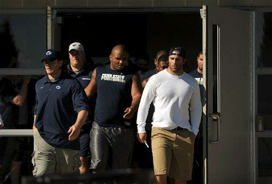 Penn State senior linebacker Michael Mauti, left, and senior running back Michael Zordich, right,  lead the football team out of the Lasch building on the Penn State University campus,  to give a statement in support of their team, Wednesday, July 25, 2012 in State College, Pa. (AP Photo/The Centre Daily Times, Nabil K. Mark) MAGS OUT MANDATORY CREDIT Photo: AP / Centre Daily Times