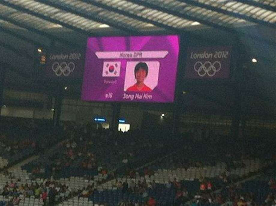 "This mobile phone photo provided by James Crossan, shows a  mistakenly displayed South Korean flag on a jumbo screen instead of North Korea's, before a women's soccer match which prompted the North Koreans to refuse to take the field for nearly an hour on Wednesday, July 25, 2012, in Glasgow, Scotland. ""We will apologize to the team and the National Olympic Committee and steps will be taken to ensure this does not happen again,"" organizers said. (AP Photo/James Crossan) Photo: ASSOCIATED PRESS / AP2012"