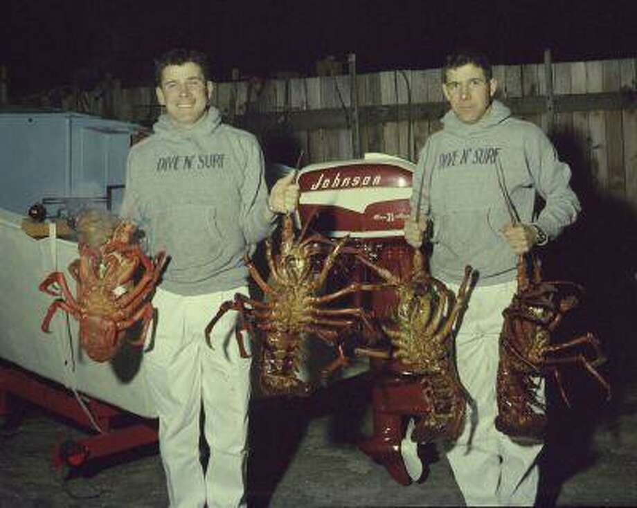 Bill Meistrell, left, and Bob Meistrell, right, with lobsters caught off the coast. (Body Glove Photo) Photo: ALL