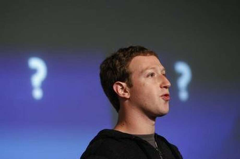 "Facebook Chief Executive Mark Zuckerberg, seen unveiling the ""Graph Search"" feature during a media event at the company's headquarters in Menlo Park, California January 15, 2013. REUTERS/Robert Galbraith / X90034"