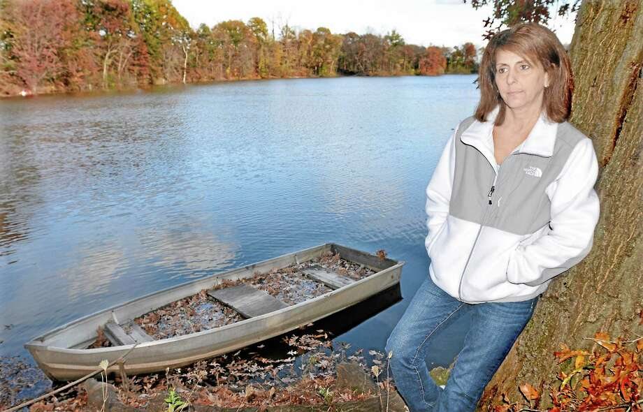 Patricia Ghezzi, 52, is photographed by the pond where she spends time reflecting on her life and taking pictures that decorate the walls of her Middletown home. Ghezzi is battling lung cancer and a brain tumor. She will be speaking Nov. 7 at the Middlesex Hospital Cancer Center on Saybrook Road in Middletown. Catherine Avalone - The Middletown Press Photo: Journal Register Co. / TheMiddletownPress
