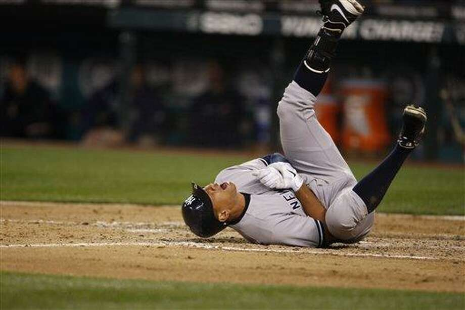 New York Yankees' Alex Rodriguez rolls on the ground after being hit by a pitch in the eighth inning of a baseball game against the Seattle Mariners, Tuesday, July 24, 2012, in Seattle. (AP Photo/Kevin P. Casey) Photo: ASSOCIATED PRESS / AP2012